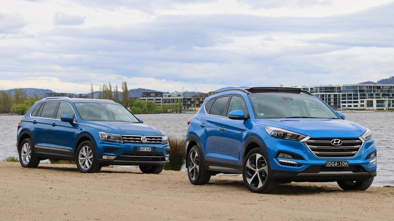 A Caribbean Blue Volkswagen Tiguan and Ara Blue Hyundai Tucson in Australia