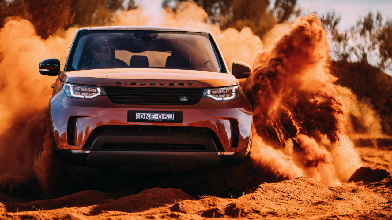 2017 Land Rover Discovery First Edition Namib Orange Off Road – Chasing Cars