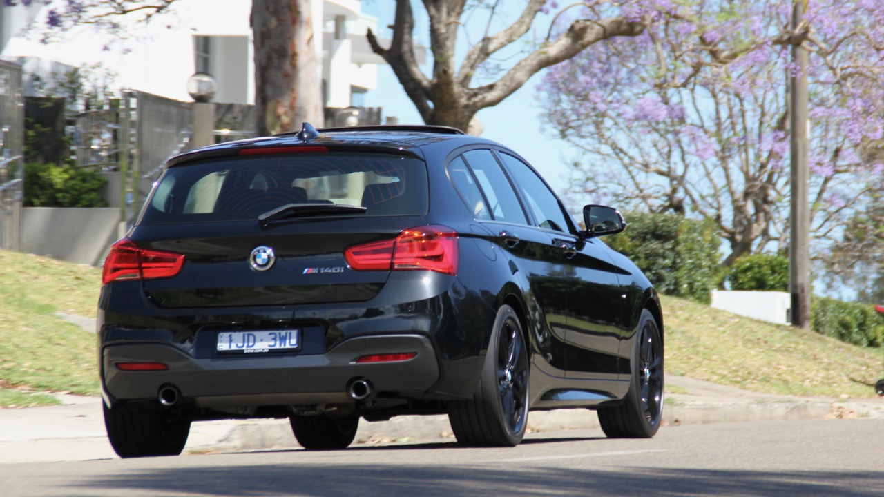 2018 BMW M140i Review Driving Rear End Black Sapphire