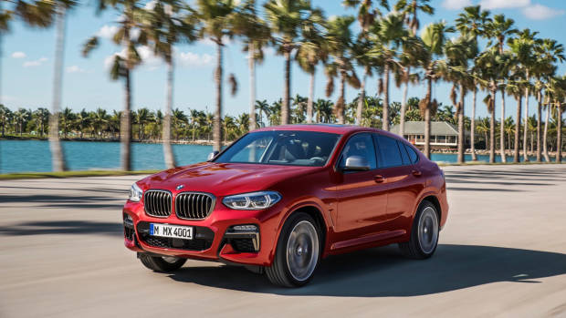 2019 BMW X4 M40i red front 3/4 motion