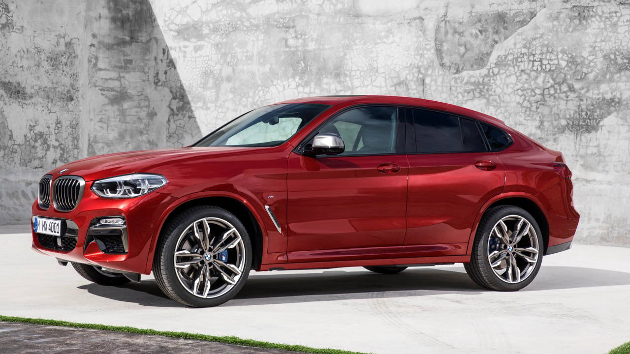 2019 BMW X4 M40i red front side 3/4