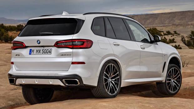 2019 BMW X5 M Sport white rear 3/4