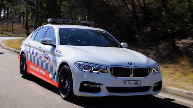 BMW 530d NSW Police front 3/4 moving