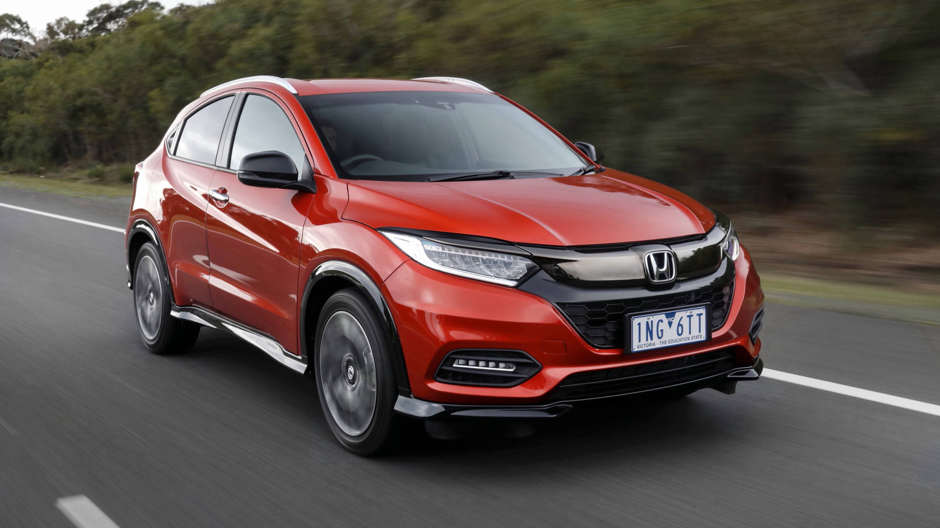 2019 Honda HR-V RS Phoenix Orange front driving