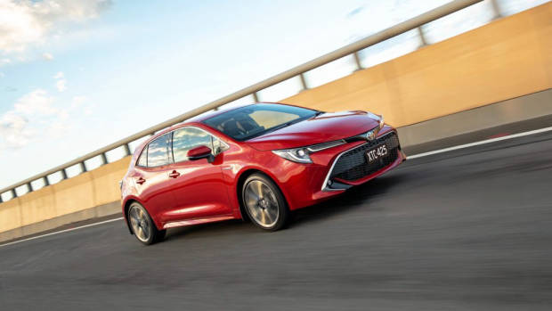 2019 Toyota Corolla ZR hybrid red front 3/4 driving