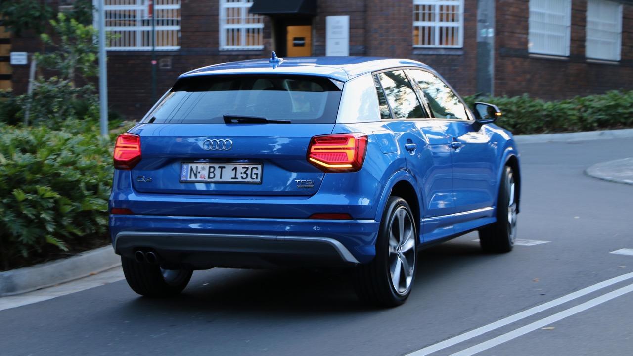 Audi Q2 sport Ara Blue back end driving