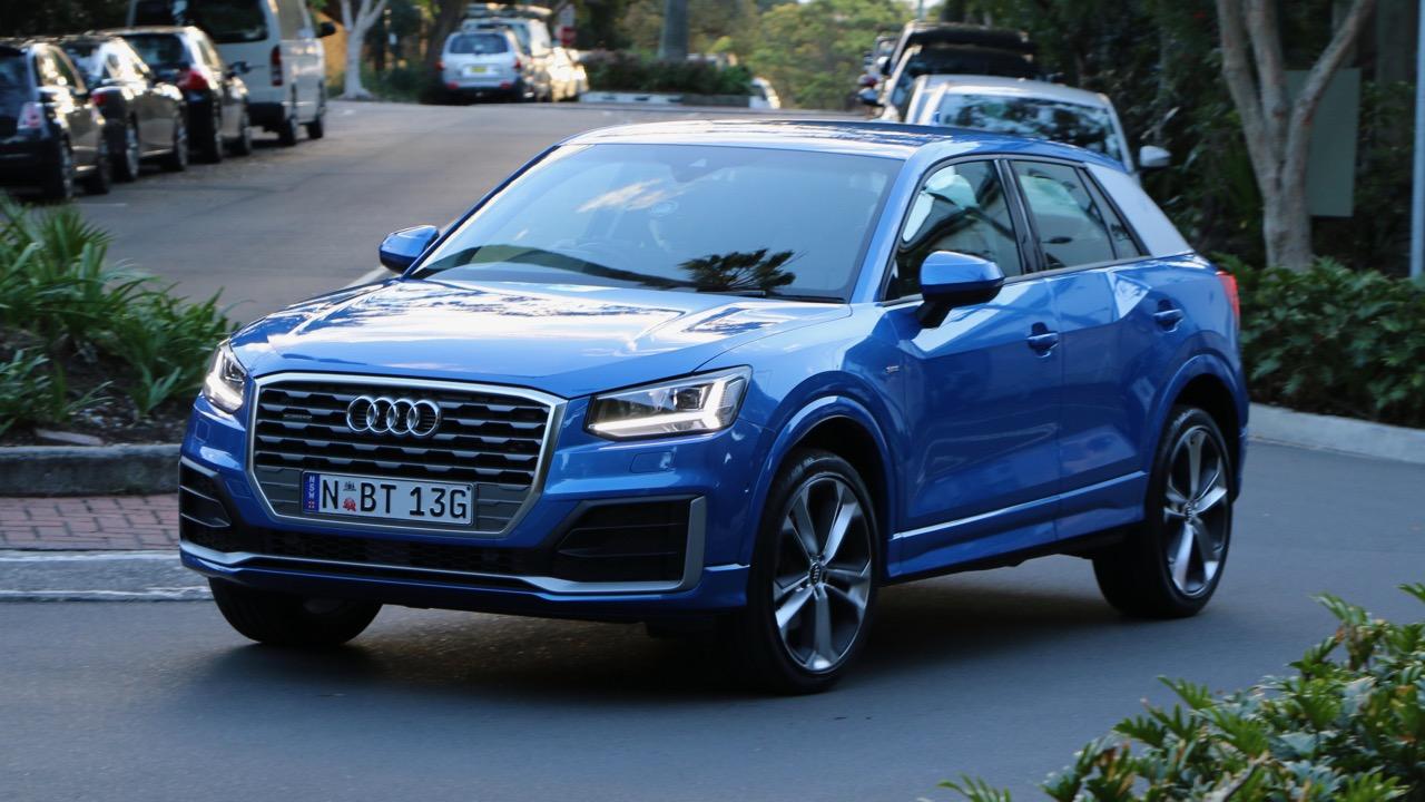 Audi Q2 sport Ara Blue front end driving