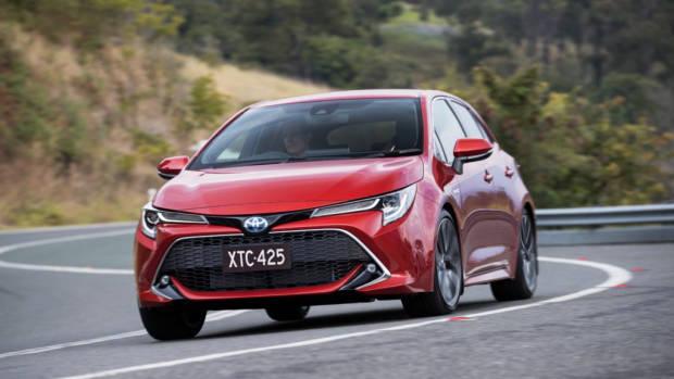 2019 Toyota Corolla ZR hybrid Volcanic Red front 3/4 cornering
