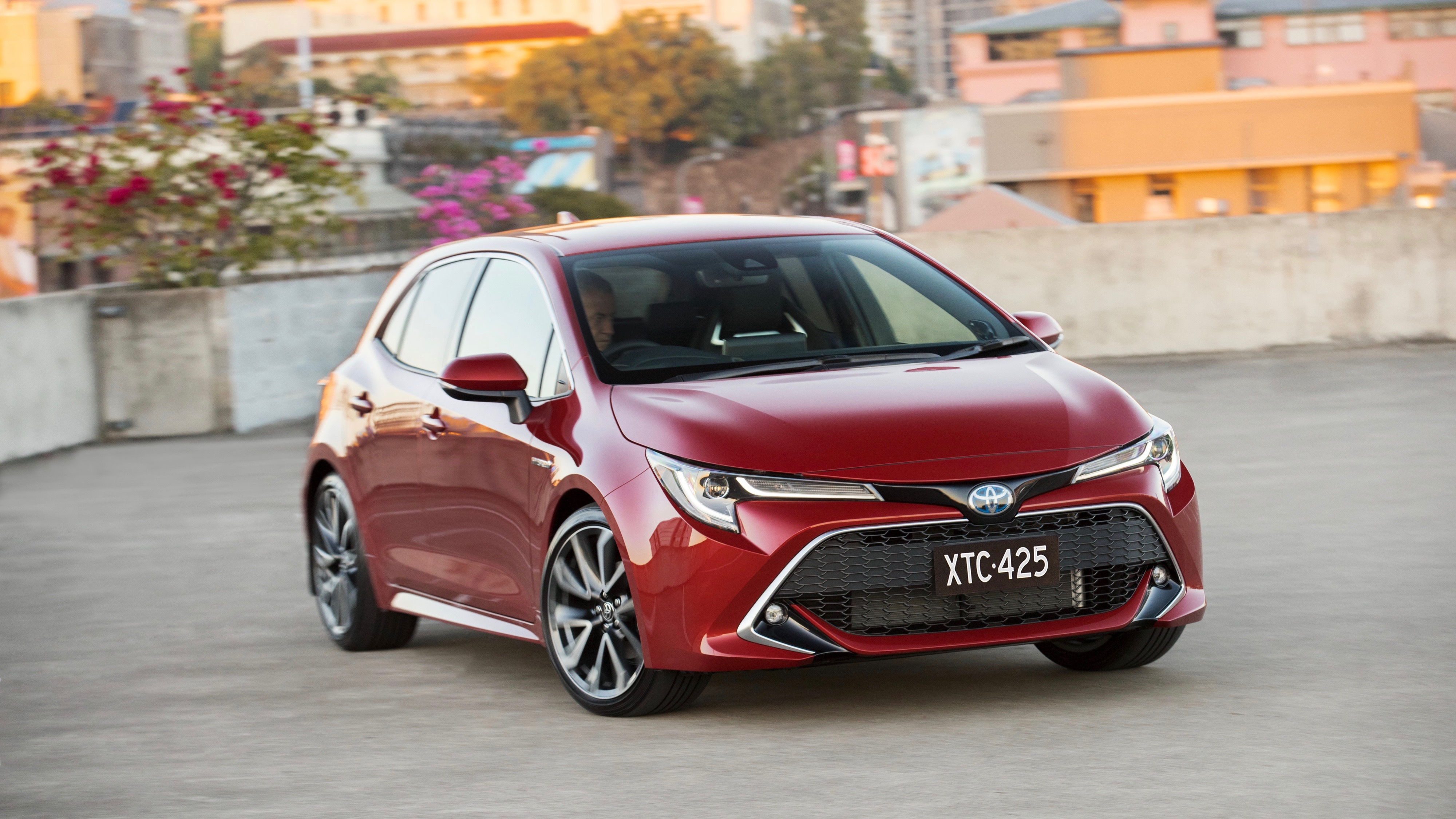 2019 Toyota Corolla ZR hybrid Volcanic Red front 3/4