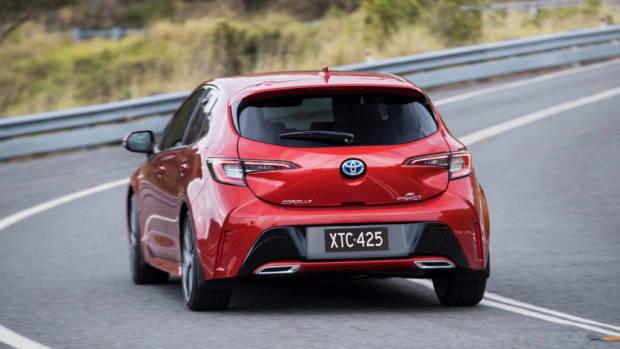 2019 Toyota Corolla ZR hybrid Volcanic Red rear 3/4 corner