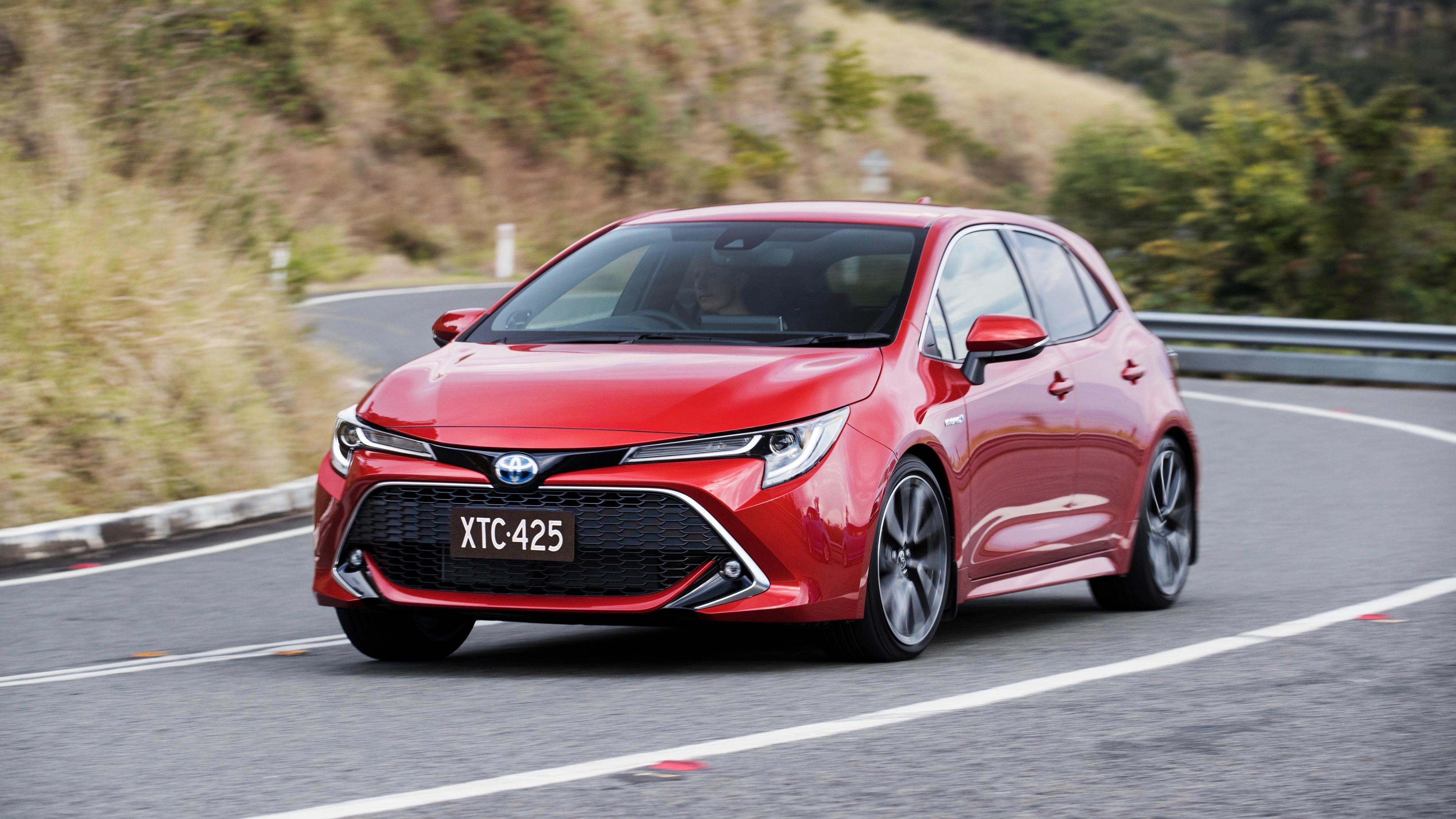 2019 Toyota Corolla ZR hybrid Volcanic Red side corner