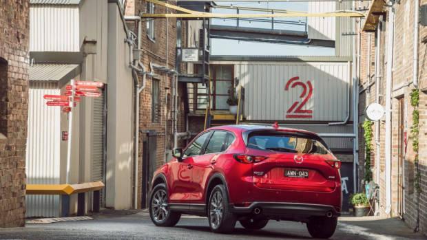 2019 Mazda CX-5 Akera Soul Red Crystal rear 3/4 far