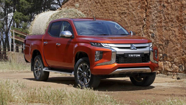 2019 Mitsubishi Triton orange front 3/4 right