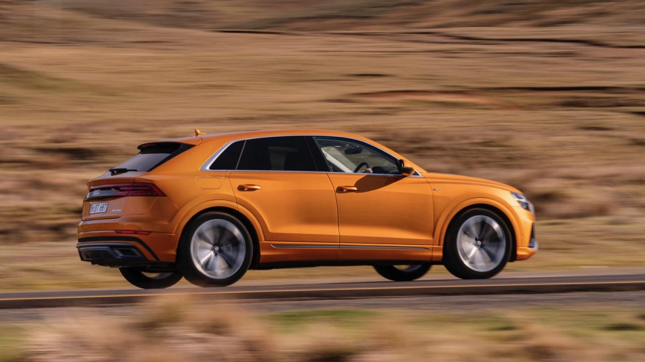 2019 Audi Q8 Dragon Orange profile driving