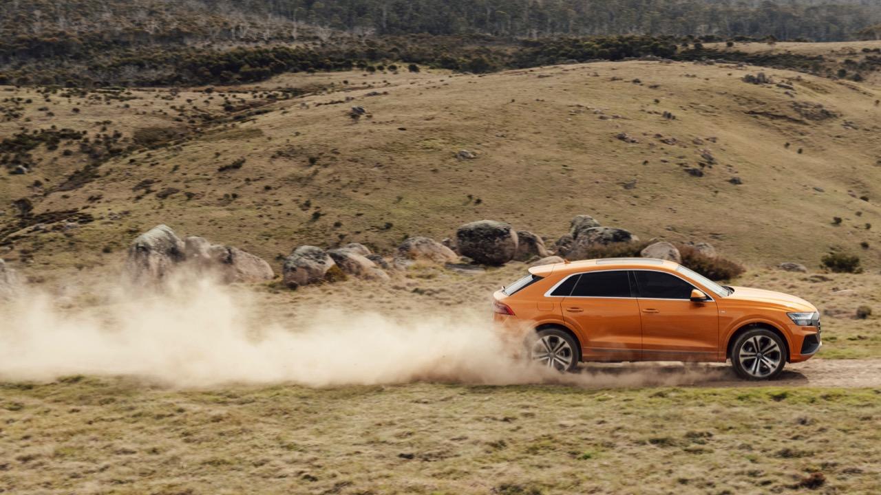 2019 Audi Q8 Dragon Orange profile off road