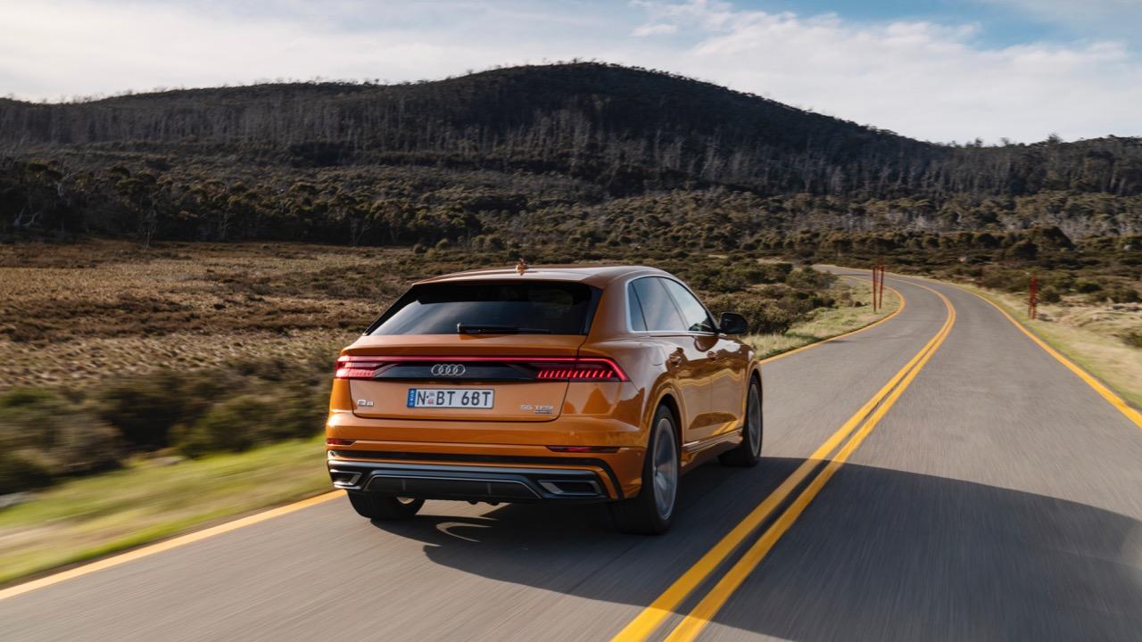 2019 Audi Q8 Dragon Orange rear driving