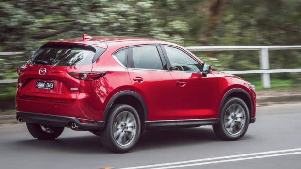 2019 Mazda CX-5 Akera Soul Red Crystal rear 3/4 driving