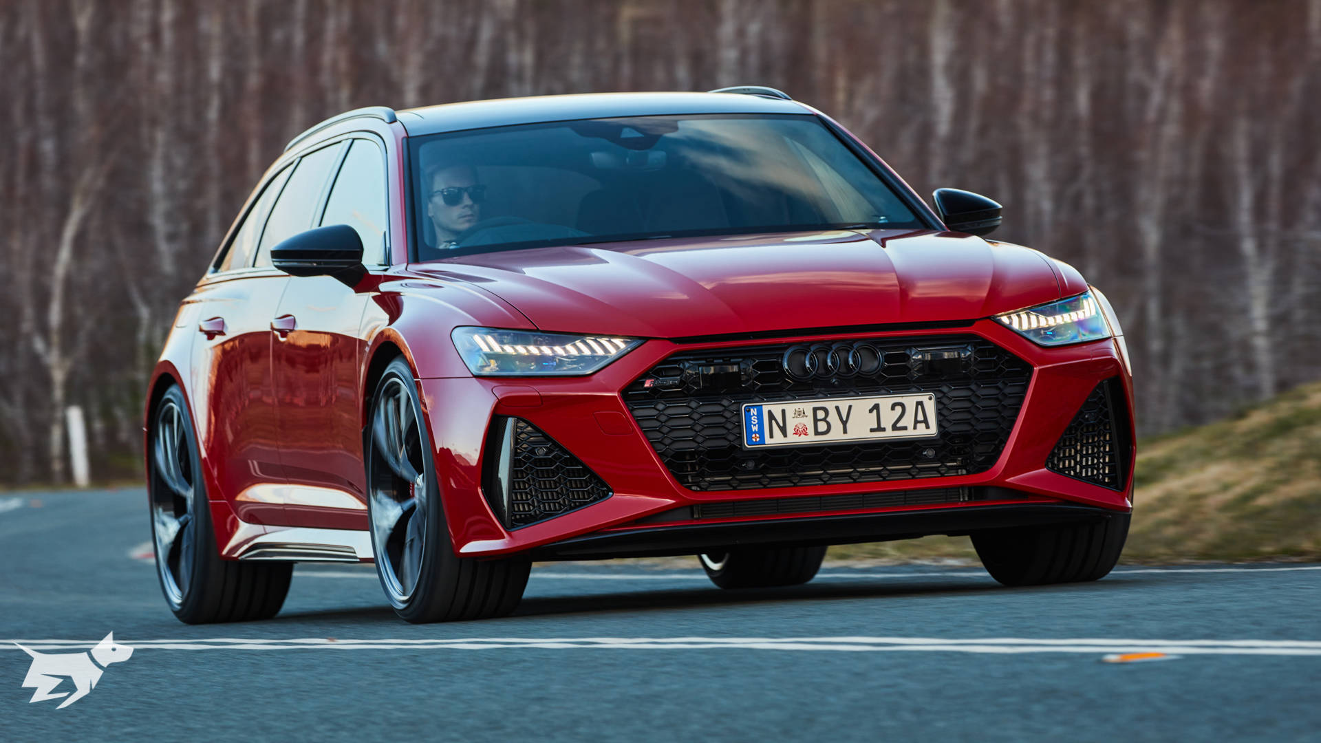 2020 Audi RS6 Avant in Tango Red driving on the road